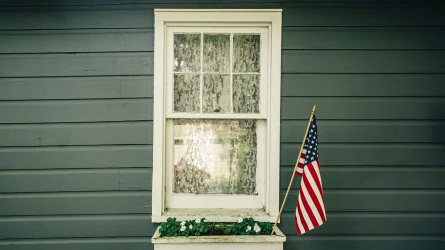 Window box with an American flag outside a house