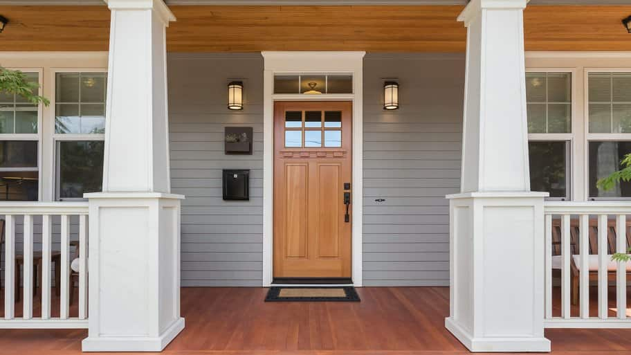 Front porch of home with stained door