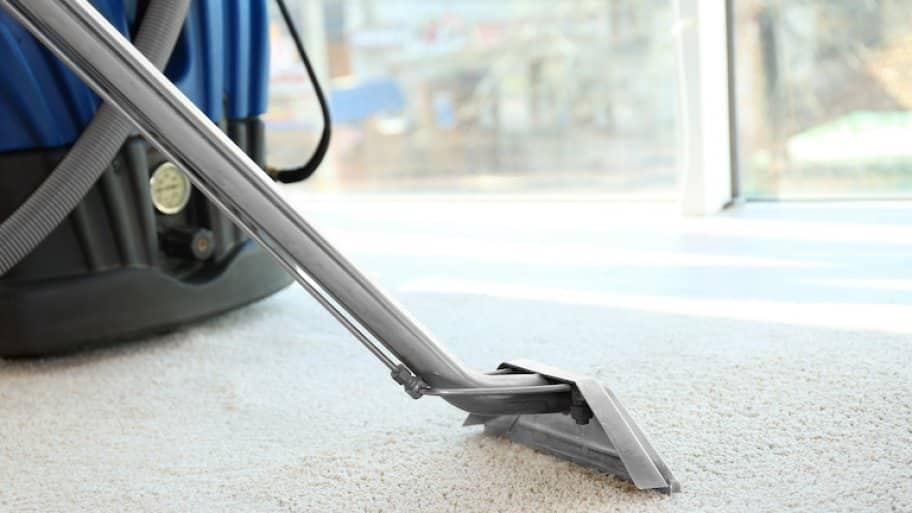 Steam vapor cleaner removing dirt from cream colored carpet