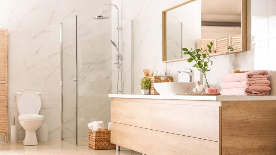 The interior of a stylish bathroom with a shower unit