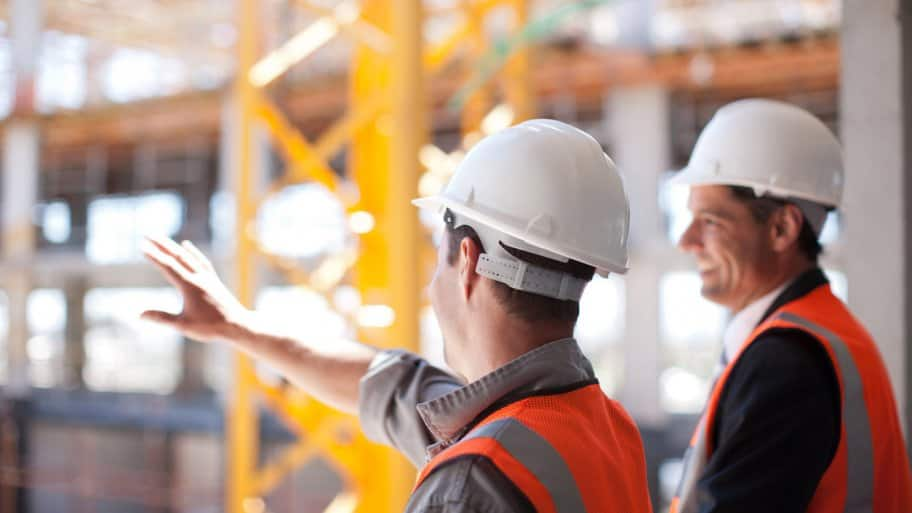 A subcontractor showing the construction site to a contractor
