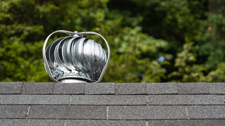 A turbine ventilator on top of a roof (Photo by Rosemarie - stock.adobe.com)