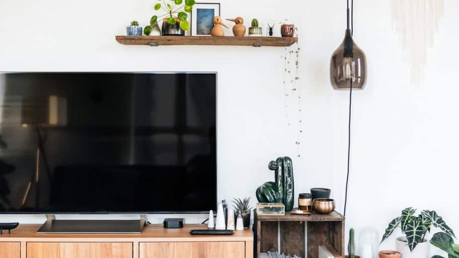 A television unit in a modern bright living room (Photo by Oscar Wong/Moment via Getty Images)