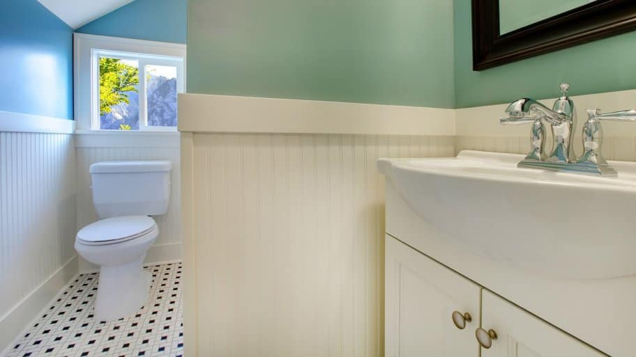 Green painted bathroom with white wainscoting (Photo by irina88w / iStock / Getty Images Plus via Getty Images)