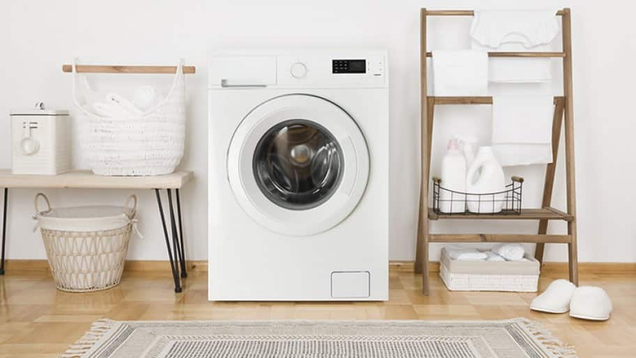 A washing machine in a laundry room