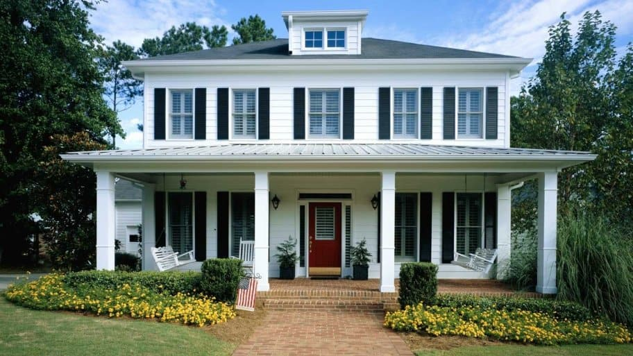 A white wooden house with a front porch