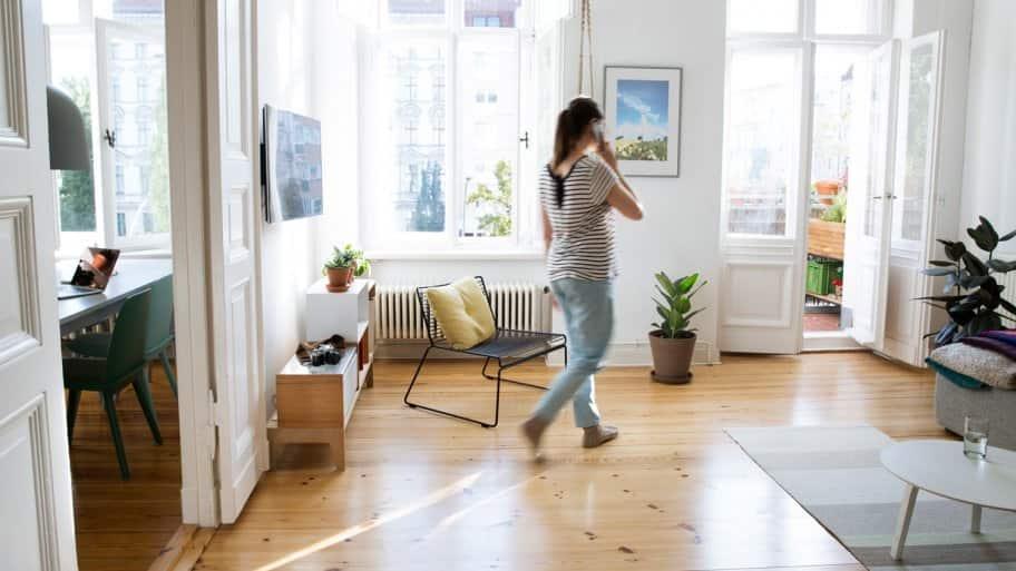 A woman walking across a room