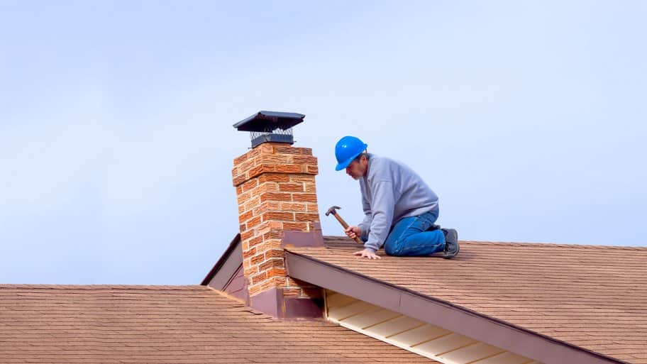 A worker installing new roof