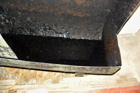 Even when a fuel oil tank has been pumped, about 5-10 gallons of sludge and oil will remain in the tank after pumping, says Gorman. (Photo courtesy of Timothy Gorman Contractor)