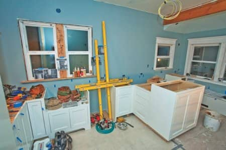 A home improvement project, such as this kitchen, remodel requires various experts. Think carefully before deciding whether to tackle a project yourself. (Photo courtesy of member Andrea S., Seattle)