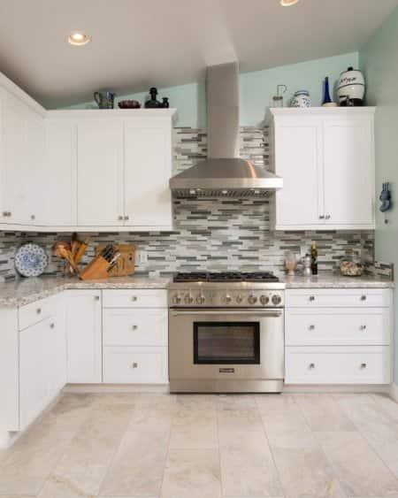 stainless steel appliances, backsplash, remodeled kitchen
