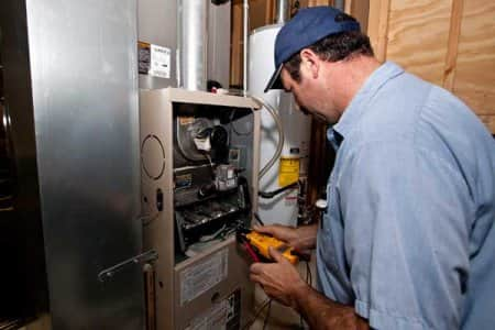 furnace repairman testing furnace