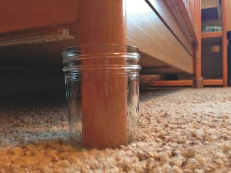 Parents concerned with scorpions can place crib feet in glass Mason jars, since bark scorpions can't crawl up glass. (Photo by Bulwark Exterminating)