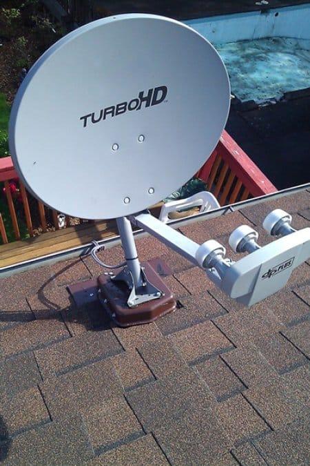 satellite dish screwed on asphalt shingle roof