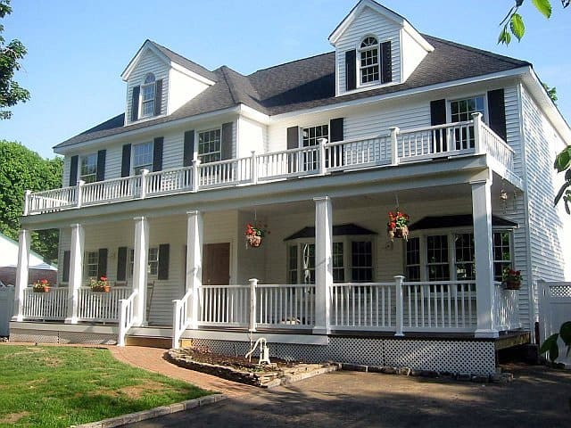 house exterior with multi-level porches