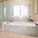 bathroom remodel with silver and gold mosaic tiles