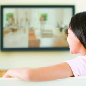 woman watching wall mounted tv