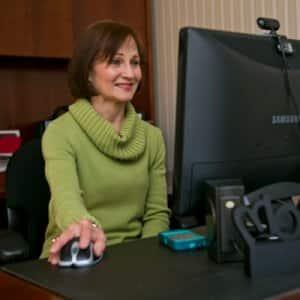 Pam Slibeck at her desktop computer