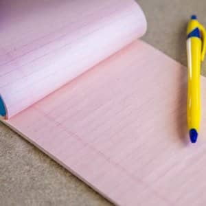 Pad of paper and a pen. (Photo by Photo by Katelin Kinney)