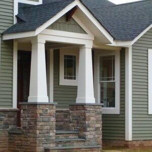 home exterior with brick porch