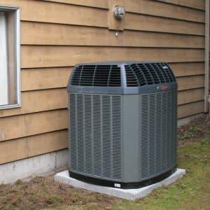 gray heat pump on concrete block