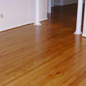 refinish or replace hardwood flooring