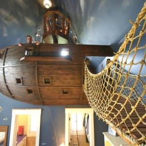 Kuhl Design Build created an intricate pirate-themed bedroom that includes a rope walkway to a suspended pirate ship bed. (Photo courtesy of Kuhl Design Build)