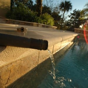 leaking swimming pool equipment over a pool.
