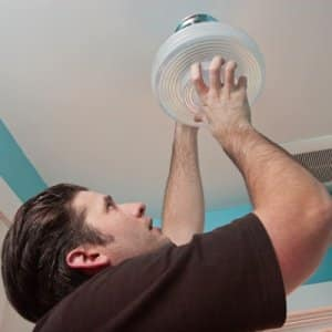 A handyman with Budget Right Handyman in Oak Park, Illinois, works to install a new light fixture in an Angie's List member's home. (Photo by Jay Madden)