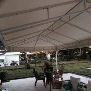 large awning covers patio with outdoor living room furniture
