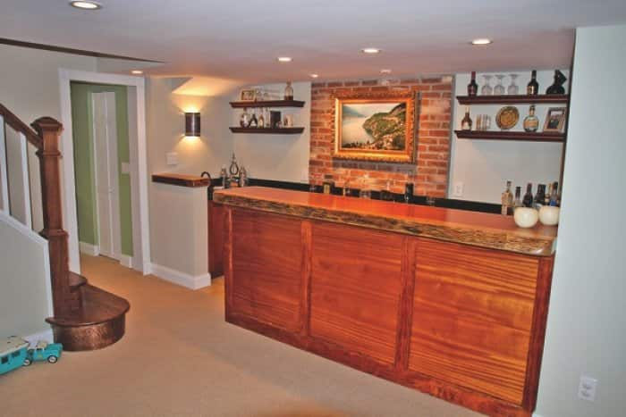 custom-built wood bar with trim in finished basement