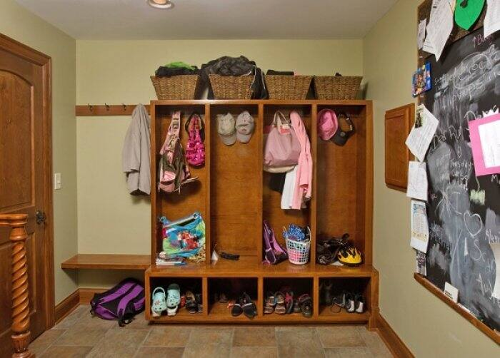 Adding a mudroom onto the house not only provides extra storage options, but the additional square footage increases your home's value. (Photo courtesy of Nicholson Builders)