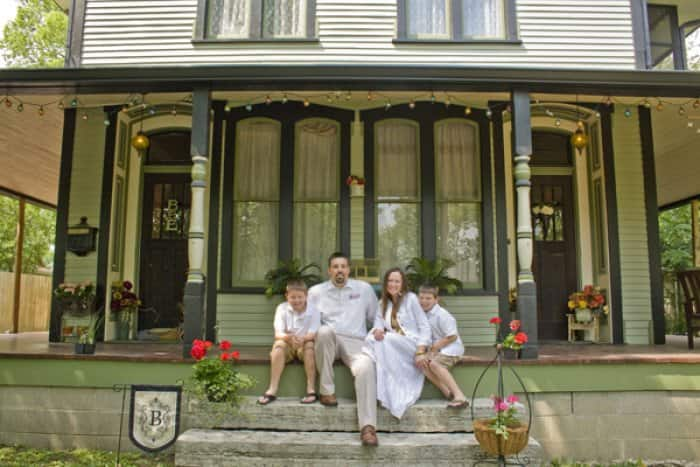 Scott and Cori Brown live in their restored home at 226 W. Madison St., Franklin, with their sons Gage, 9, (left) and Aiden, 7. (Photo by Brandon Smith)
