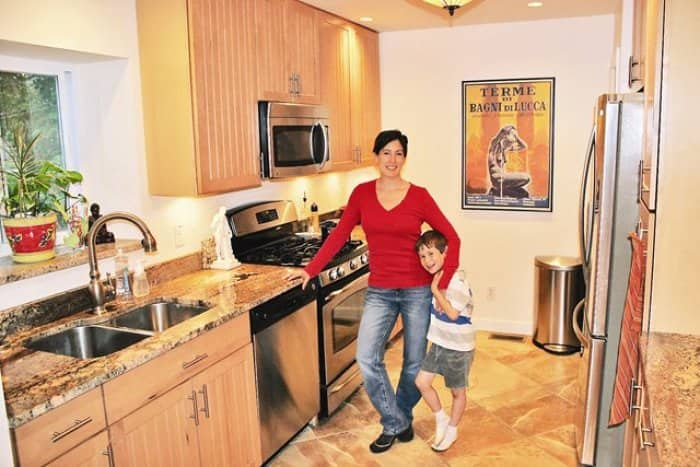 University City homeowner Julia Mariani, shown here with son Sam, says finding a contractor with the proper municipal license was important when she remodeled her kitchen. (Photo courtesy of Julia Mariani)
