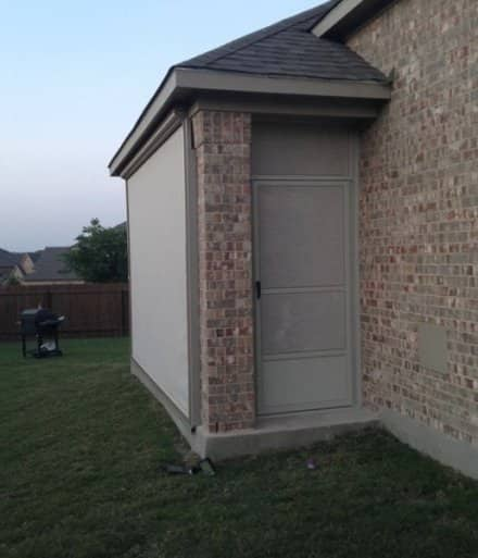 screened in patio with side entry door.