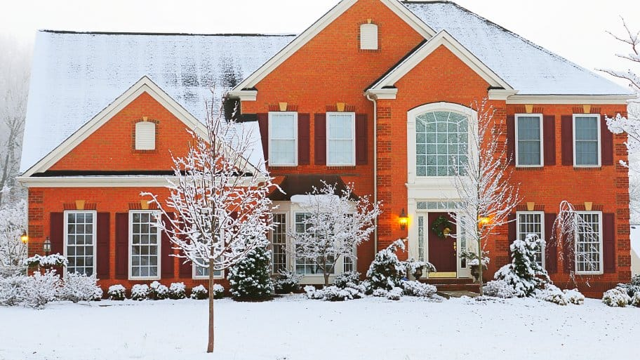orange brick house in winter