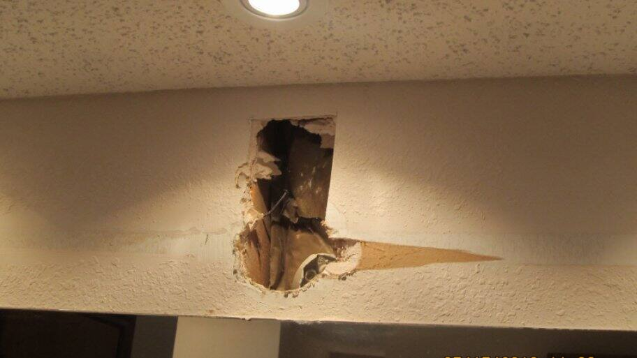 Hole in upper interior wall.
