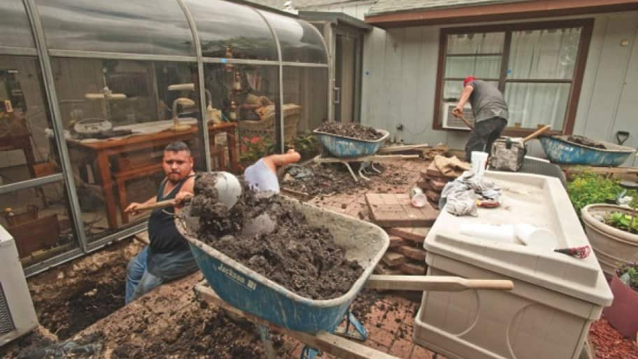 When possible, foundation repair crews work outside San Antonio homes to adjust foundations or add support. (Photo by Aiessa Ammeter)