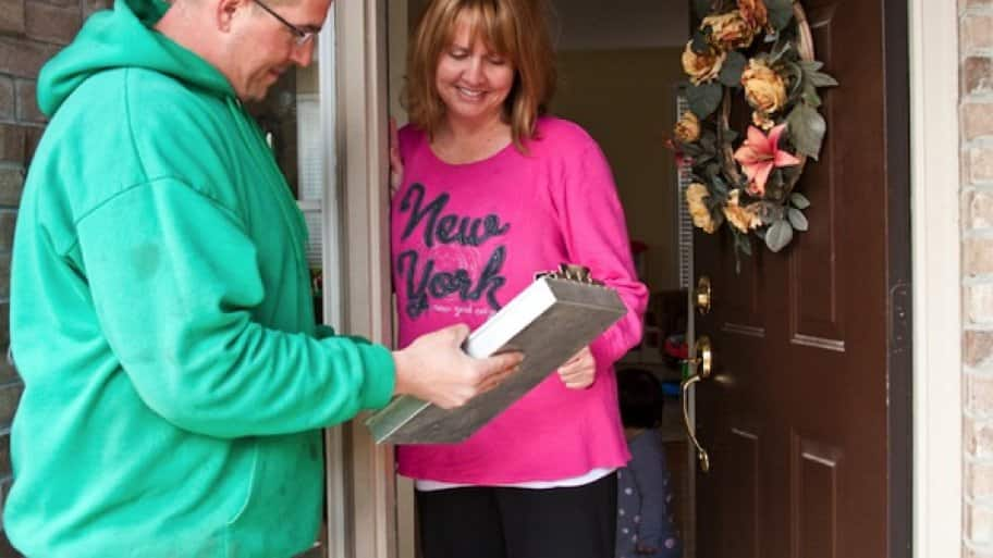 contractor gives home improvement estimate to woman