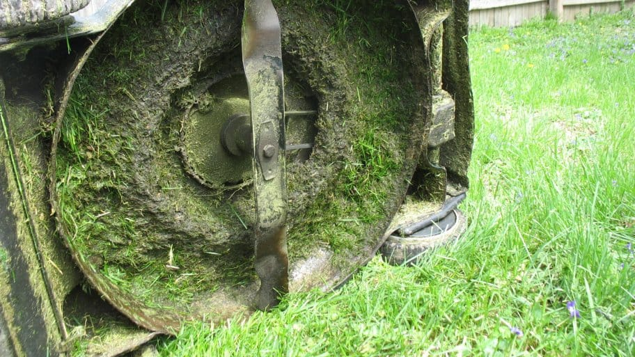 dirty lawn mower undercarriage (Photo by Katie Jacewicz)
