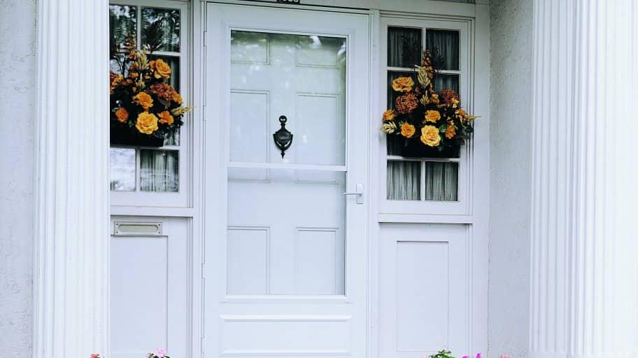 white Pella storm door on home exterior