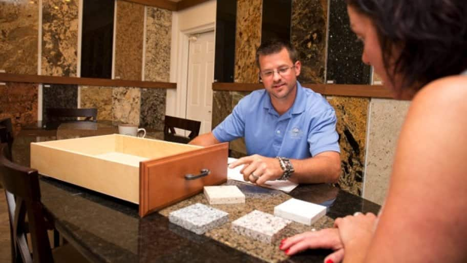Matt Schuckman, of Olympia Stone in Indianapolis, shows a customer counter samples. (Photo by Eldon Lindsay)