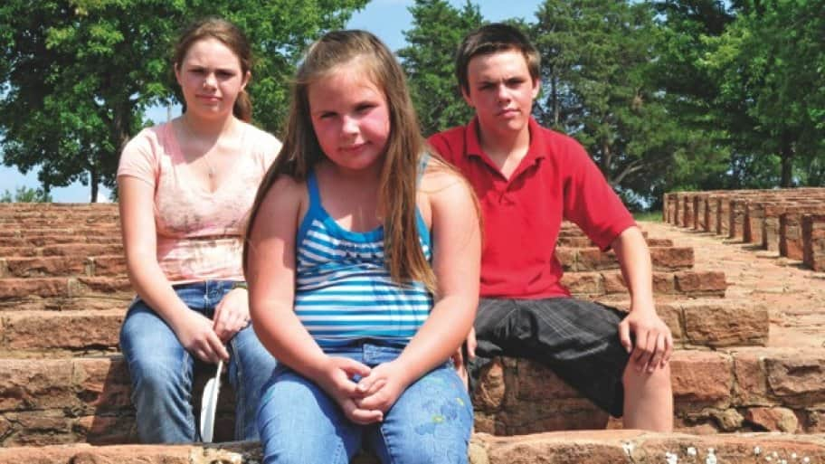 Johnna Hurt's three oldest children — Alyssa (left), Cameron (center) and Rainy — were all diagnosed with lead poisoning in 2005 and still suffer from the effects. (Photo by Nick Oxford)