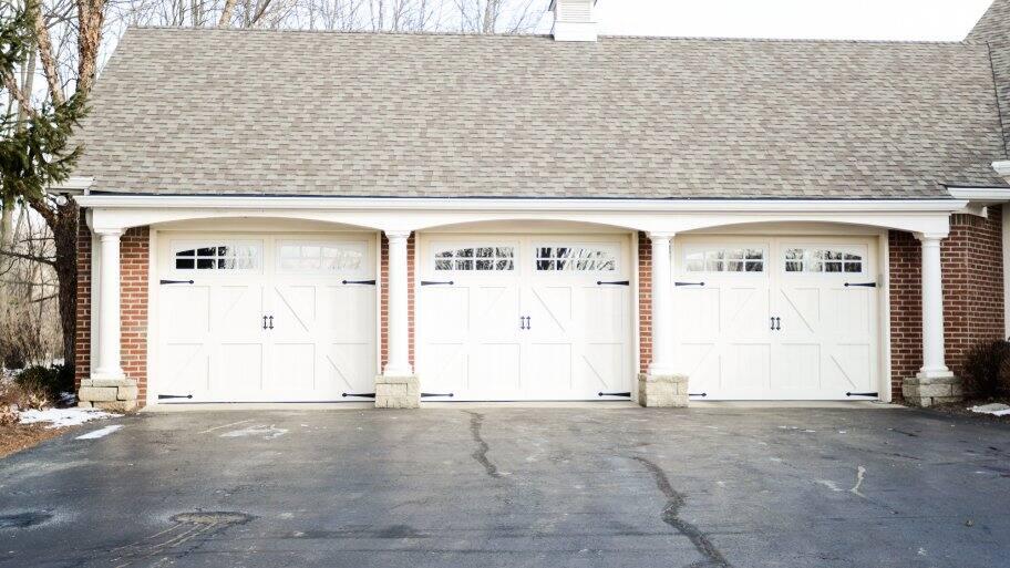 three overhead garage doors on house