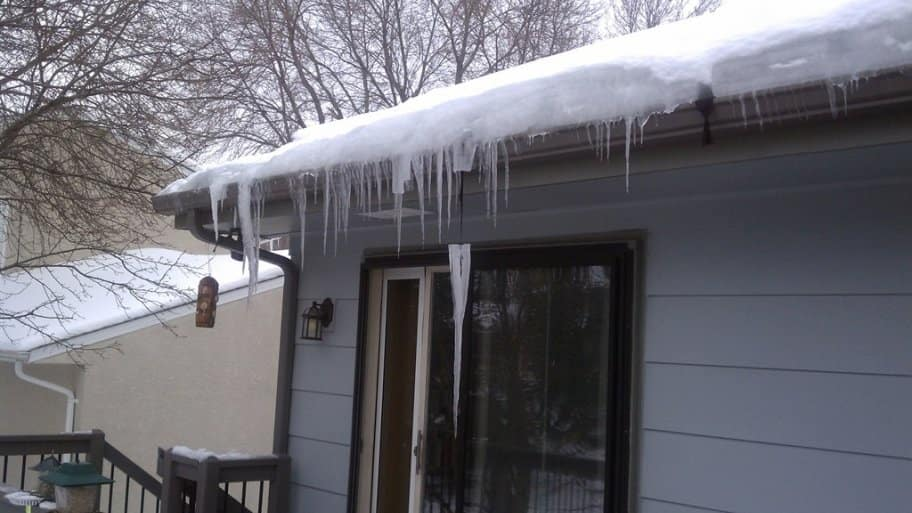 A visible inspection of your roof line can reveal a buildup of snow and ice and an accumulation of icicles. (Photo courtesy of Angie's List member Donna B. of Mendota Heights, Minn.)
