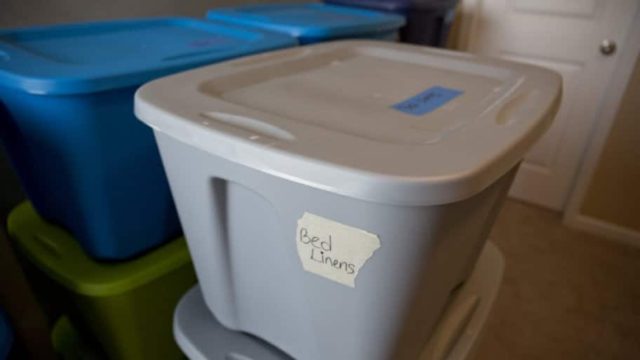Plastic bins labeled for moving day.