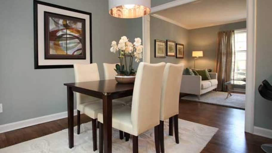 The art in this home's dining and living rooms is hung at a lower height, which works well for folks who are seated. (Photo courtesy of Kim Trouten of Staged for Selling)