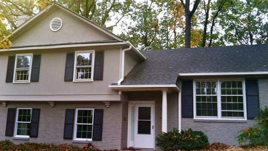 AFTER: Painting both the brick, siding and shutters updated this home. (Photo courtesy of Kim Trouten of Staged for Selling)