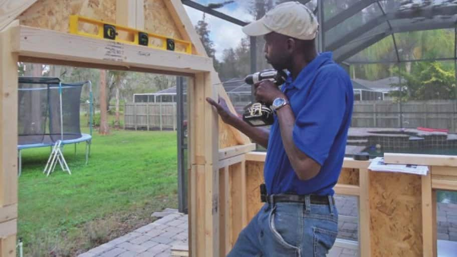 Troy Johnson putting up a garden cottage
