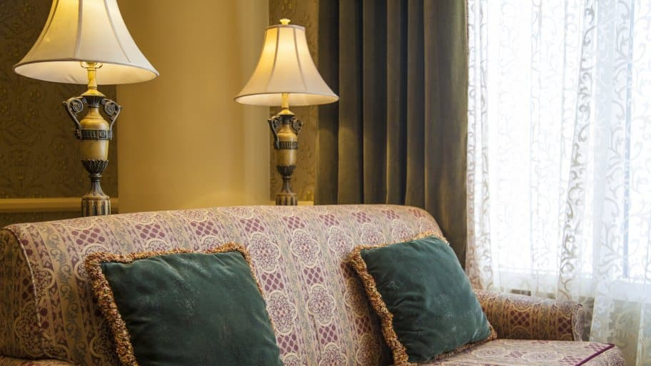 two vintage lamps behind couch